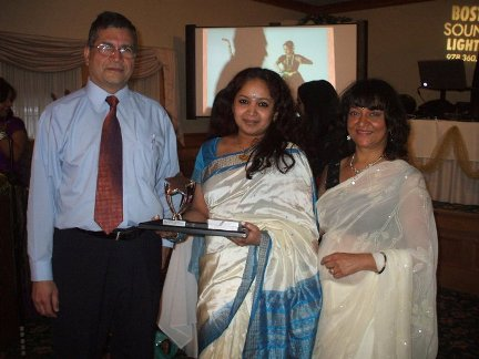 Neha receiving excellence award